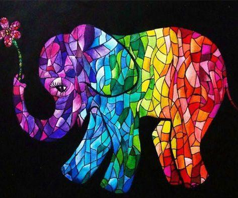 Colorful Elephant Sniffs A Flower
