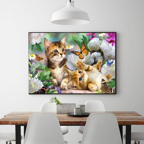 Two Cute Kittens Playing With Butterflies In The Flowers